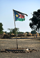 A battered South Sudanese flag in a small village along the Sobat river not far from Nasir.