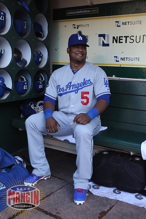 OAKLAND, CA - JUNE 19:  Juan Uribe #5 of the Los Angeles Dodgers gets ready in the dugout before the game against the Oakland Athletics at O.co Coliseum on Tuesday June 19, 2012 in Oakland, California. Photo by Brad Mangin