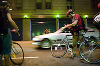 3 July 2005 - New York City, NY, USA - Riders get their manifests stamped at an alleycat checkpoint on 43rd street in New York City, USA, July 3rd 2005. Alleycats are urban cycle races held informally - without notification of the authorities - on open roads and in real traffic, to simulate the messenger's working conditions. Photo Credit: David Brabyn<br />