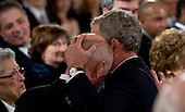 Washington, DC - January 15, 2009 -- United States President George W. Bush embraces a man after delivering his farewell speech to the Nation from the East Room of the White House in Washington, D.C., Thursday, January 15, 2009..Credit: Mannie Garcia - Pool via CNP
