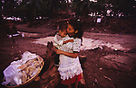 Central America, Honduras, Choluteca. Devastation in the aftermath of Hurricane Mitch. High winds and flooding. Soil erosion caused by deforestation. Refugee young mother and child.Houses and infrastructure destroyed.
