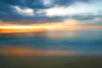 Dramatic sunset at Ke'iki beach on the north shore of Oahu. Blurred for artistic effect.