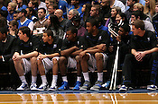 Injured Duke guard Kyrie Irving watches his team on the bench at the Duke vs. St. Louis basketball game Saturday, December 11, 2010. (Photo by Al Drago)