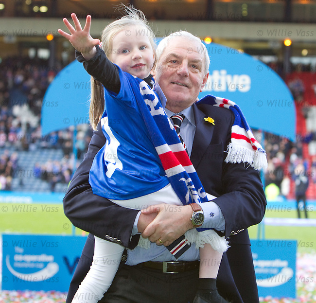 Rangers mamager Walter Smith makes off with the League Cup as he takes grand-daughter Jessica on a lap of honour