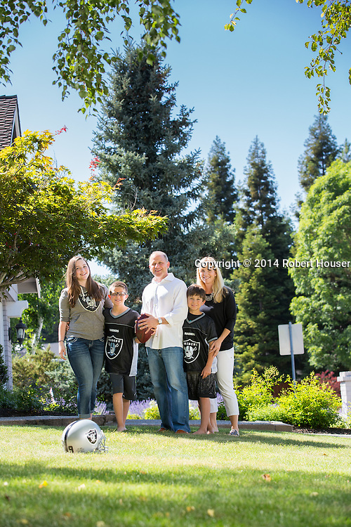 Portrait of Marc Badain and family