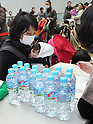 March 24, 2011, Tokyo, Japan - Plastic bottles of water are distributed to families with infants at a civic center on Thursday, March 24, 2011, a day after traces of radioactive iodine-131 exceeding the limit considered safe for infants was detected in one of purification plant in Tokyo. Anxiety over Japan's food and water supplies soared following warnings about radiation leaking from Japan's tsunami-damaged nuclear power plant into Tokyo's tap water at levels unsafe for babies over the long term. (Photo by Natsuki Sakai/AFLO) [3615] -mis-