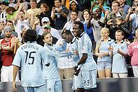 Roger Espinoza, Bobby Convey, C.J Sapong, Kei Kamara (23) celebrate Sporting K C's third goal... Sporting Kansas City defeated New England Revolution 3-0 at LIVESTRONG Sporting Park, Kansas City, Kansas.