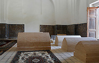 Low angle view of interior of Rukhabad Mausoleum, Samarkand, Uzbekistan, pictured on July 18, 2010, in the afternoon. The Rukhabad Mausoleum (Abode of the Spirit) was built by Timur over the grave of the mystic Sheikh Burhan al-Din Sagarji. The mausoleum has three entrances. The simple interior walls are covered with alabaster plasterwork with a glazed tile band. A  19th century carved wooden door leads to the tomb. Samarkand, a city on the Silk Road, founded as Afrosiab in the 7th century BC, is a meeting point for the world's cultures. Its most important development was in the Timurid period, 14th to 15th centuries. Picture by Manuel Cohen.