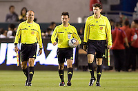 Referee Edvin Jurisevic (c) and AR's Paul Scott (l) and Peter Manikowski (r) heading out at halftime. The Philadelphia Union and CD Chivas USA played to 1-1 draw at Home Depot Center stadium in Carson, California on Saturday evening July 3, 2010..