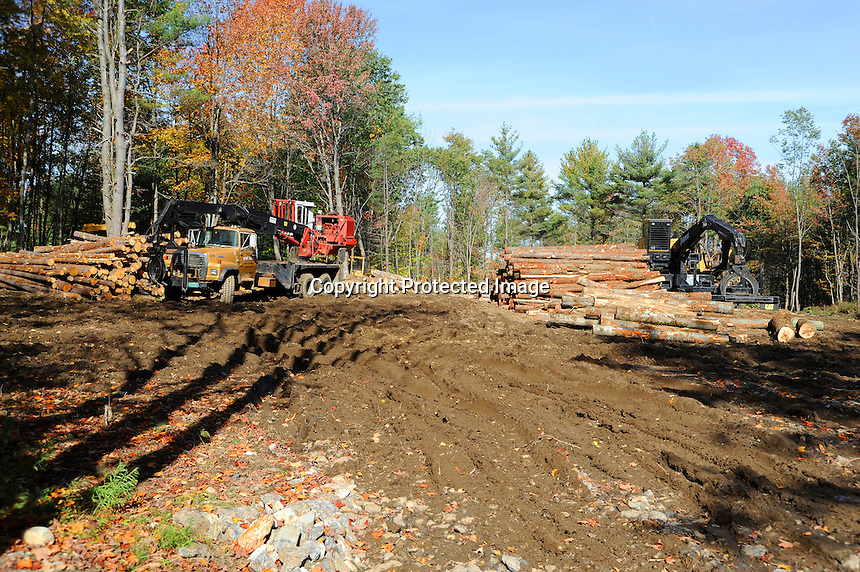 Machinery and Cut Wood on Building Lot in Rural Southern New Hampshire ...