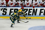 ST CHARLES, MO - MARCH 19:  Cassidy Vinkle (22) of the Clarkson Golden Knights passes the puck up the ice during the Division I Women's Ice Hockey Championship held at The Family Arena on March 19, 2017 in St Charles, Missouri. Clarkson defeated Wisconsin 3-0 to win the national championship. (Photo by Mark Buckner/NCAA Photos via Getty Images)