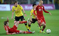 FUSSBALL   1. BUNDESLIGA   SAISON 2011/2012   30. SPIELTAG Borussia Dortmund - FC Bayern Muenchen            11.04.2012 Toni Kroos (am Boden) und Arjen Robben (re, beide FC Bayern Muenchen) gegen Kevin Grosskreutz (li)  und Shinji Kagawa (re, beide Borussia Dortmund)