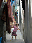 A girl in a narrow street in the Al-Shalti refugee camp in Gaza. Residents of the Palestinian territory are still reeling from the death and destruction of the 2014 war with Israel, and the continuing siege of the seaside territory by the Israeli military.