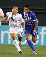 Charlie Davies #9 of the USA chests the ball down in front of Mariano Acevedo #11 of Honduras during a CONCACAF Gold Cup match at RFK Stadium on July 8 2009 in Washington D.C. USA won 2-0.