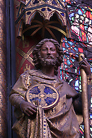 Detail of statue of apostle in the nave of the Upper chapel, La Sainte-Chapelle (The Holy Chapel), 1248, Paris, France. La Sainte-Chapelle was commissioned by King Louis IX of France to house his collection of Passion Relics, including the Crown of Thorns. The Sainte-Chapelle is considered among the highest achievements of the Rayonnant period of Gothic architecture. Picture by Manuel Cohen