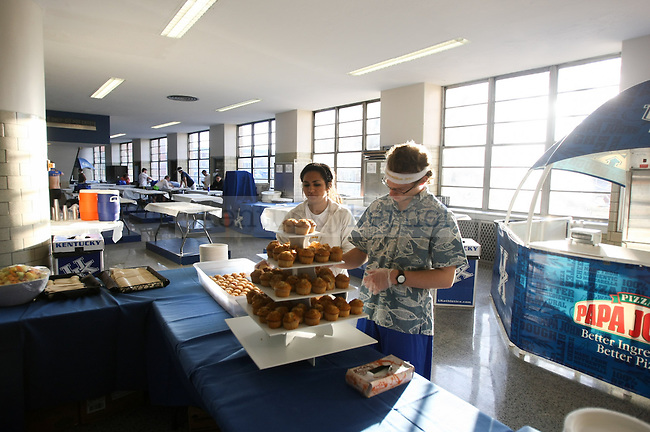 Sophomore psychology and biology major Christina Griffin (left) and junior civil engineering major Patrick Heeb lay out muffins for dancers at Dance Blue at Memorial Coliseum in Lexington, Ky., on Sunday, February 15, 2015. Photo by Cameron Sadler | Staff