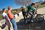 Members of the Los Altos High School Green Team pedal a bike to blend ingredients into smoothies during a break between classes.