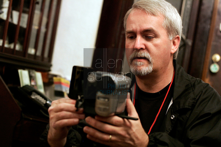 Joey Ward sets up a video camera to investigate activity at the Green Manor Restaurant in Union City, Ga. on Saturday night, Jan. 20, 2007. Several members of the West Georgia Paranormal Research Society spent the night at the house. People have said the ghost of a woman, Florence Westbrook, is active in the historic home.