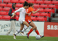 COLLEGE PARK, MD - OCTOBER 28, 2012:  Domenica Hodak (2) of the University of Maryland moves into the back of Ashley Flinn (5) of Miami during an ACC  women's tournament 1st. round match at Ludwig Field in College Park, MD. on October 28. Maryland won 2-1 on a golden goal in extra time.