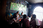 Sondre Lerche talks with friends at Casino El Camino in downtown Austin, Texas during the 2011 SXSW Music Festival. From his left: Einar Olsson, Fredrik Vogsborg, Njal Leinan Clementsen, Omar Johnsen, Linn Frokedal, and Richard Myklebust.