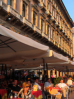 People outdoor at cafe at the Galleria Vittorio Emanuele on the Piazza Duomo in Milan, Italy