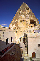 Goreme, Cappadocia, Turkey, July 2005. Jillian hangs the laundry on the roof terrace underneath the Roman grave and the chapel. Dutch Photographer Frits Meyst and his wife Jillian Macdonald restored an old rock house in the village of Goreme. Since Roman Times people have been cutting graves and home out of the Soft tufo 'Fairy Chmney' rocks of Cappadocia. Photo by Frits Meyst / MeystPhoto.com