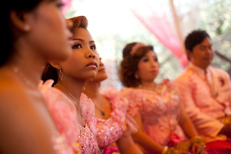 Bridesmaid at a buddhist wedding in a small village outside of Phnom Penh, Cambodia. <br /> <br /> Photos &copy; Dennis Drenner 2013.