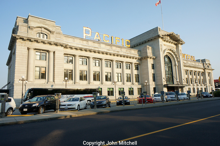 Pacific Central train and bus station, Vancouver, BC, Canada. This heritage building is also known as the Canadian Northern Railway Station. This Neoclassical Revival building is the built on reclaimed land that was part of False Creek. It continues to function as a train station but in 1993 the station became a multi transportation station where intercity buses also depart from. The heritage designation includes the neon sign.