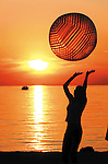 Sentinel/Dan Irving.Amber Wood, 19, of Wyoming, bumps a beach ball with her friends at sunset Monday at Holland State Park..(6/30/03) - DIGITAL .