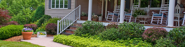 Front garden landscaping plant flower stock for Front porch hanging plants