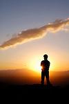Hiker watching sunset from Gate's Pass, Tucson Mountain Park, Tucson, Arizona