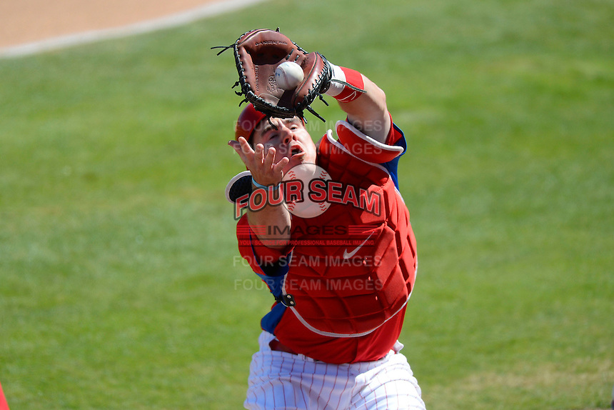 Philadelphia Phillies catcher Tommy Joseph #73 catches a foul ball pop up during a Spring Training game against the Washington Nationals at Bright House Field on March 6, 2013 in Clearwater, Florida.  Philadelphia defeated Washington 6-3.  (Mike Janes/Four Seam Images)