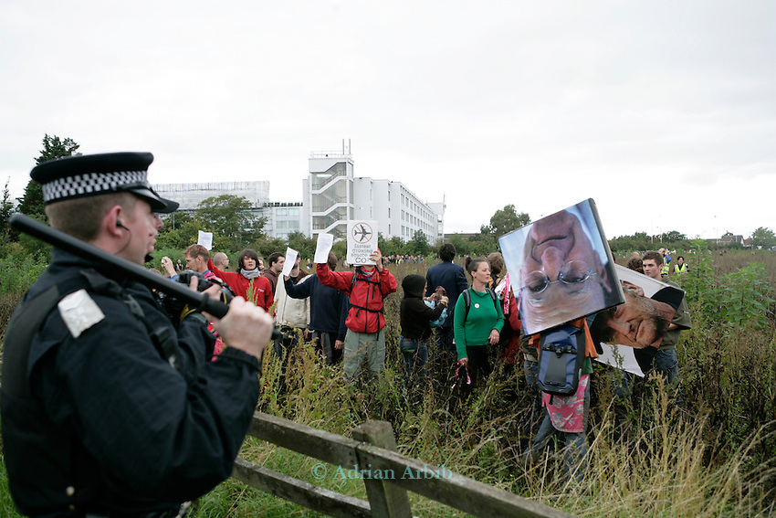 Climate change protesters at Climate Camp, Heathrow make their way to the BAA offices but are met by riot police.<br />2,000 protesters gathered at an impromptu camp set up to protest against the UK's airport expansion program.