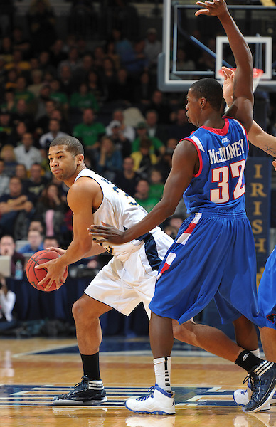Joey Brooks (32) looks to pass around DePaul's Charles McKinney (32).