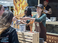 Fries from the Home Frites truck at a street fair in the Chelsea neighborhood of New York on a warm Saturday, April 30, 2016. (© Richard B. Levine)
