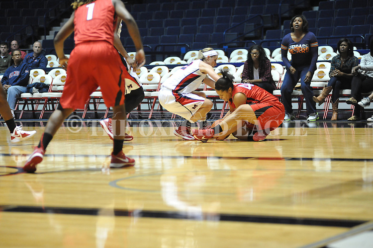 Ole Miss' Gracie Frizzell (12) vs. Lamar's Jasmin Henderson (44) in women's college basketball at the C.M. &quot;Tad&quot; Smith Coliseum in Oxford, Miss. on Monday, November 19, 2012.  Lamar won 85-71.