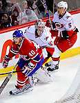 31 March 2010: Carolina Hurricanes' goaltender Cam Ward (30) wanders behind his goal in an effort to maintain control of the play during game action against the Montreal Canadiens at the Bell Centre in Montreal, Quebec, Canada. The Hurricanes defeated the Canadiens 2-1. Mandatory Credit: Ed Wolfstein Photo