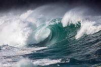 A big hollow wave breaks at Waimea Shorebreak, North Shore, O'ahu.