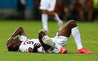 Joel Campbell of Costa Rica lies on the floor injured after being fouled