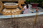 "A mother and daughter pray to a statue of ""Phat Thich Ca Mau Ni"" or ""Sakyamuni Buddha"" at the Giac Lam Pagoda in Tan Binh District in Ho Chi Minh City, Vietnam....Kevin German / LUCEO"
