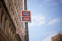 """A NYC Dept. of Transportation """"Don't Honk"""" sign in the New York neighborhood of Chelsea is seen on Tuesday, January 29, 2013. The city has announced that in an effort to """"declutter"""" they are removing the signs which originally went up during the Koch administration. The $350 fine is not going away. (© Richard B. Levine)"""