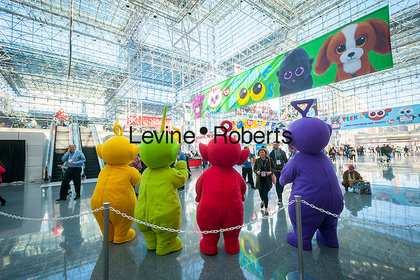 Actors dressed as Teletubbies greet visitors at the 114th North American International Toy Fair in the Jacob Javits Convention center in New York on Sunday, February 19, 2017.  The four day trade show with over 1000 exhibitors connects buyers and sellers and draws tens of thousands of attendees.  The toy industry generates over $26 billion in the U.S. alone and Toy Fair is the largest toy trade show in the Western Hemisphere. (© Richard B. Levine)