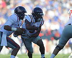 Ole Miss quarterback Randall Mackey (1) fakes a handoff to Ole Miss' Jeff Scott (3) vs. Kentucky at Commonwealth Stadium in Lexington, Ky. on Saturday, November 5, 2011. ..