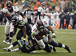 Seattle Seahawks defensive back Tye Smith (22), tackles Denver Broncos running back Montee Ball during the third quarter at CenturyLink Field on August 14, 2015 in Seattle Washington.  The Broncos beat the Seahawks 22-20.  © 2015. Jim Bryant Photo. All Rights Reserved.