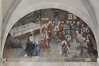 Table set for the Last Supper and Jesus washing the disciples' feet, and contemporary portraits of on the right, Marie-Gabrielle-Eleonore de Bourbon and on the left, Eleonore de Bourbon, 29th Abbess of Fontevraud (1575-1611), Last Supper fresco, Chapter House, Fontevraud Abbey, Fontevraud-l'Abbaye, Loire Valley, Maine-et-Loire, France. The Chapter House was built in the 16th century and its walls were painted in 1563 with frescoes of scenes from Christ's Passion by the Anjou artist Thomas Pot. The abbey itself was founded in 1100 by Robert of Arbrissel, who created the Order of Fontevraud. It was a double monastery for monks and nuns, run by an abbess. Picture by Manuel Cohen