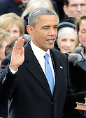 United States President Barack Obama takes the oath of office during the public swearing-in ceremony at the U.S. Capitol in Washington, D.C. on Monday, January 21, 2013..Credit: Ron Sachs / CNP.(RESTRICTION: NO New York or New Jersey Newspapers or newspapers within a 75 mile radius of New York City)