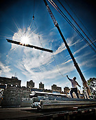 Construction photo of crane with metal, dramatic photo of construction, steel worker, metal beam, silhouette, commercial photography, industrial photography