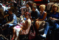 "Members of the studio audience wait for their favorite turbofolk stars on the set of ""Zvezde Granda,"" or ""Grand Stars,"" a premier turbofolk showcase on Serbian television station TV Prva, in Belgrade, Serbia on July 1, 2015.  Members of the studio audience are paid 500 dinars, approximately $5, a day for their role and participation in the tapings which last for hours."