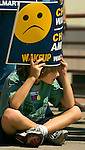 "8/16/06 Des Moines. IA Seven-year-old Satchel Perlowski holds a sign at an event Sen. Joseph Biden was speaking during an anti Wal Mart event in Des Moines Wednesday afternoon. Perlowski was there with his sister Stella, 4, and grandmother Karon.  SHE DOES SPELL KARON WITH AN ""O""..(Chris Machian/Prairie Pixel Group)"