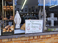 USA. New York City. Brooklyn. Bakery, undertaker and monument shop. Grave and a statue of the Virgin Mary. Brick wall. 20.10.2011 &copy; 2011 Didier Ruef